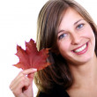 Woman and maple leaves - Foto Stock