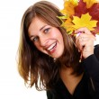 Woman and maple leaves — Stock Photo