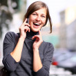 Young lady talking on mobile phone — Stockfoto