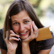 Young lady talking on mobile phone — Stock Photo #2495630