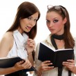 Stock Photo: Two young women reading books