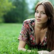 Young woman relaxing in the grass — Stock Photo #2498403