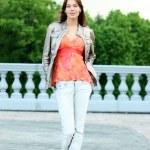 Walking woman in jeans — Stock Photo #2498654