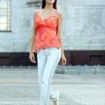 Walking woman in jeans — Stock Photo #2498684