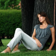 Beautiful woman in summer park — Stock Photo