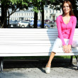 Woman has a rest sitting on a bench — Stock Photo