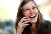 Lady talking on mobile phone — Stock Photo