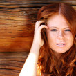 Stock Photo: Portrait of the beautiful red-haired girl
