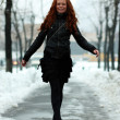 Beautiful young woman in winter park — Stock Photo