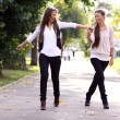 Stock Photo: Fashionable girls twins walking