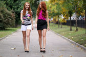 Portrait of girls walking on the street — Стоковое фото