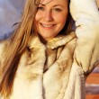 Stock Photo: Winter happy young woman