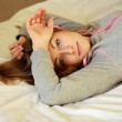 Young woman laying bed — Stock Photo