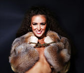 Sexual model in a fur coat — Stock Photo