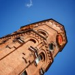 Stock Photo: Brick tower on background blue sky