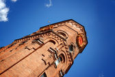 Brick tower on a background blue sky — Stock Photo