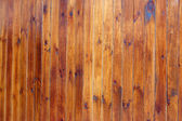 Brown lacquered wooden wall — Stock Photo