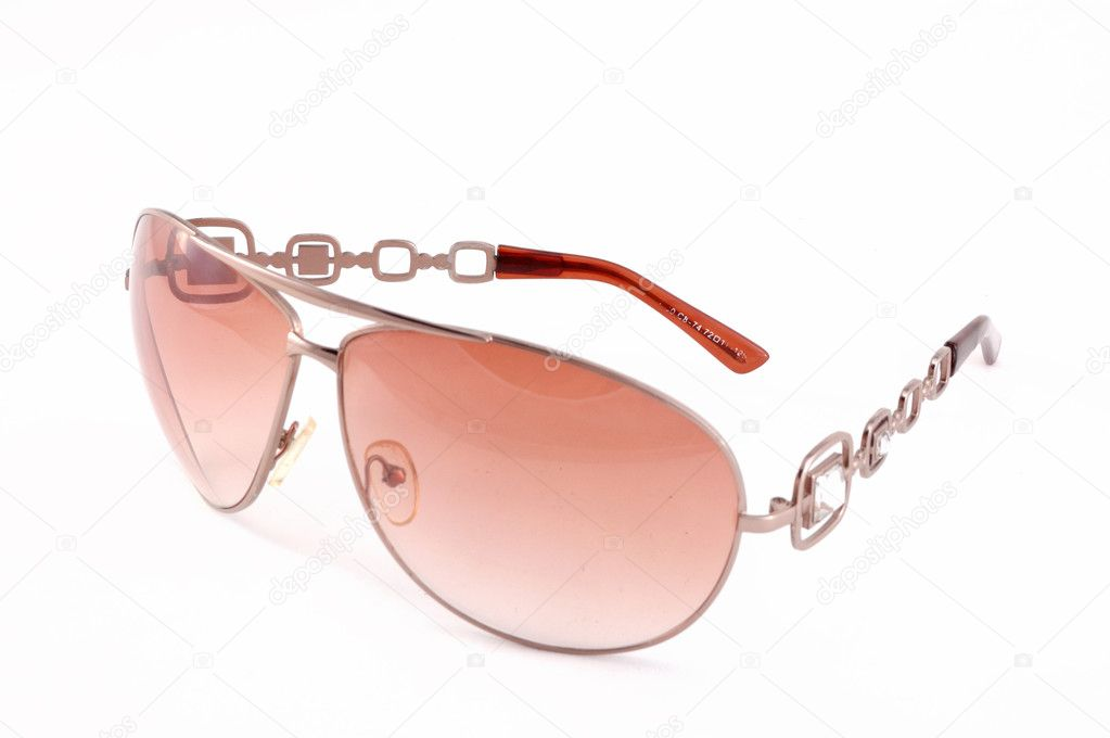 Glasses with brown glasses on a white background  Stock Photo #1183379
