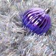 Ball and tinsel  background - Stock Photo