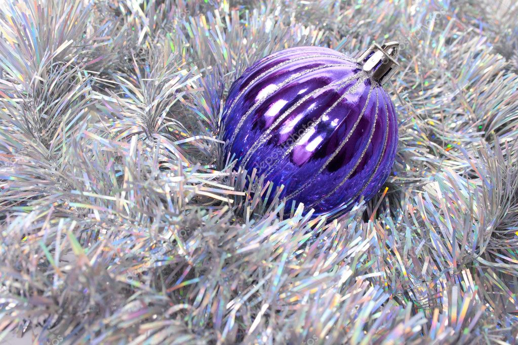 New-year decorations. Christmas ball and tinsel  background. — Stock Photo #1134654