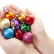 Hand and christmas toy decoration — Stock Photo