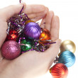 Hand and christmas toys — Stock Photo #1194344