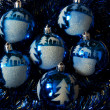 Ornaments lie on a dark blue rain — Stock Photo