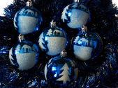 Ornaments lie on a dark blue rain — Stock Photo