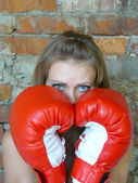 Girl in red boxing gloves — Stock Photo