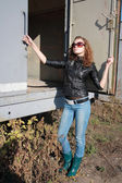 Girl poses near the iron trailer — Stock Photo