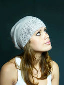 Girl in a grey cap with pastes — Stock Photo