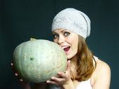 Girl with a pumpkin in hands — Stock Photo