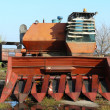 Stock Photo: Combine rusts open-air