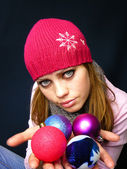Girl in a cap holds New Year — Stock Photo