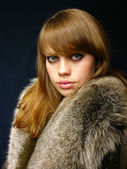 Very beautiful girl in a fur coat — Stock Photo