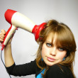 Stock Photo: Womdries hair hair dryer