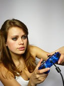 Woman plays video game — Stock Photo