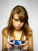 Girl plays video game — Stock Photo