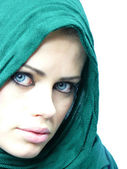 Blue-eyed woman in a green linen cape — Stock Photo