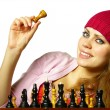 Stock Photo: Girl plays chess on a white background