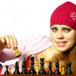 Girl plays chess — Stock Photo