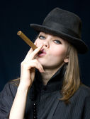 Lady in black and a cigar — Stock Photo