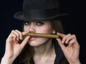 Graceful lady in black and a cigar — Stock Photo