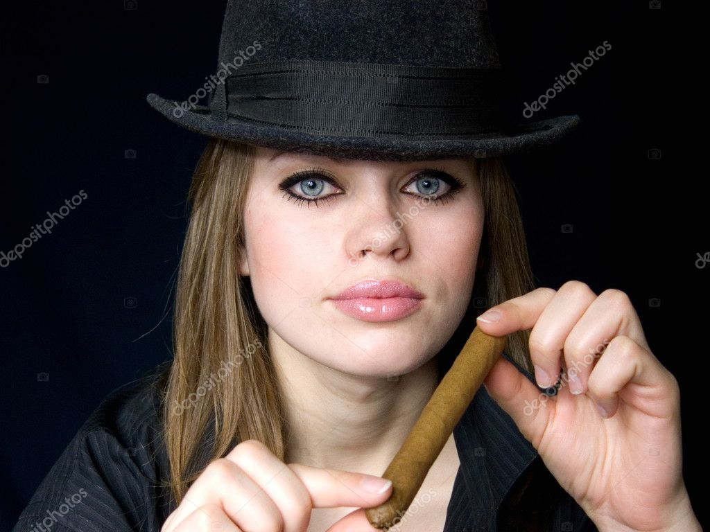 Graceful lady in a hat and a cigarette in a hand — Stock Photo #2056856