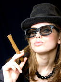 Woman in points and with a cigarette — Stock Photo