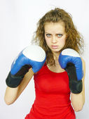Young nice sportswoman in boxing gloves — Stock Photo