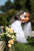 Kiss of newly-weds — Stock Photo