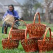 Woman makes baskets - Stock Photo