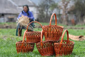 Woman makes baskets — Stock Photo