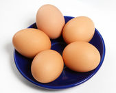Five eggs on a dish — Stock Photo
